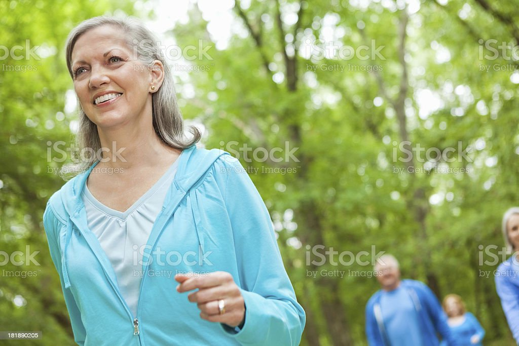 Pretty senior woman walking in park royalty-free stock photo