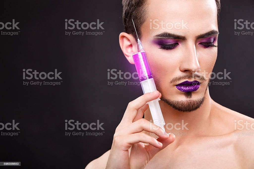 Pretty sensual gay man with art makeup and beard. royalty-free stock photo