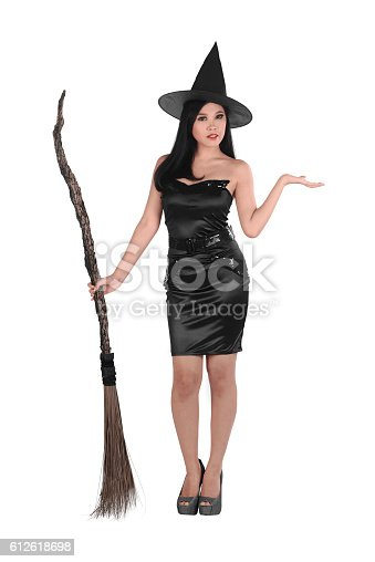 istock Pretty sexy young asian witch woman with a broom 612618698