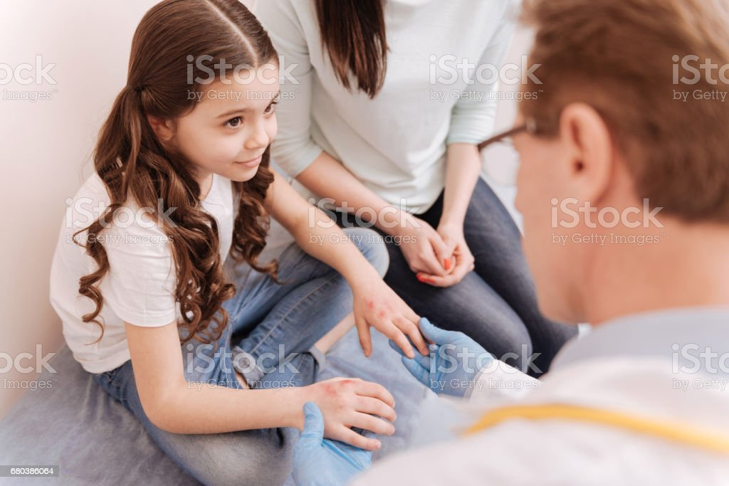 Pretty smart girl listening to experts instructions royalty-free stock photo