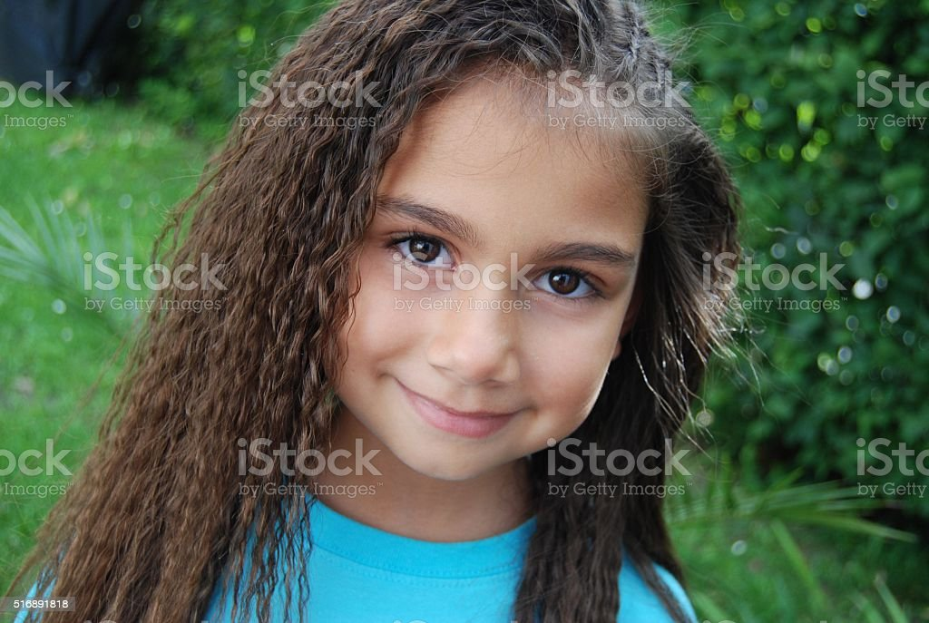 Pretty smiling dark eyed girl stock photo