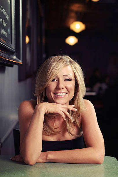 Pretty Smiling Girl in a Diner stock photo