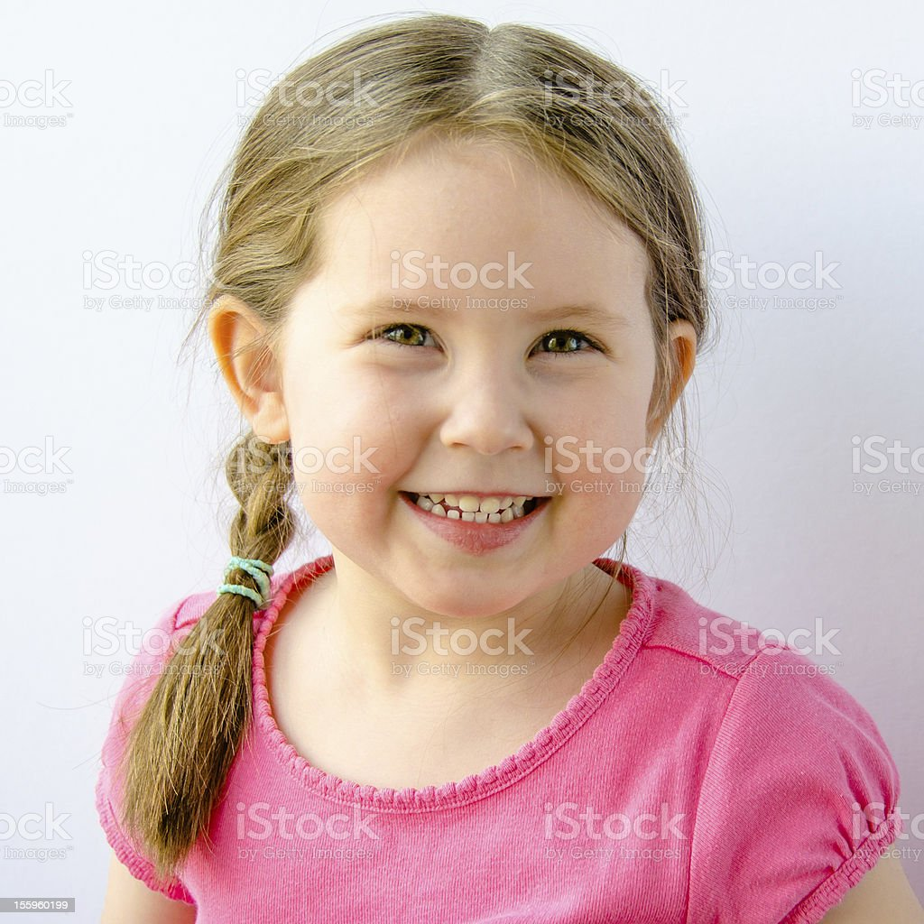 Pretty smiling girl with braids royalty-free stock photo