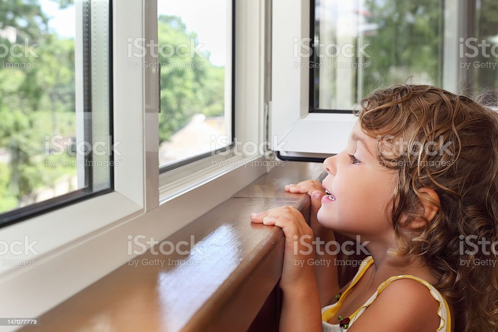 Pretty smiling little girl on balcony royalty-free stock photo