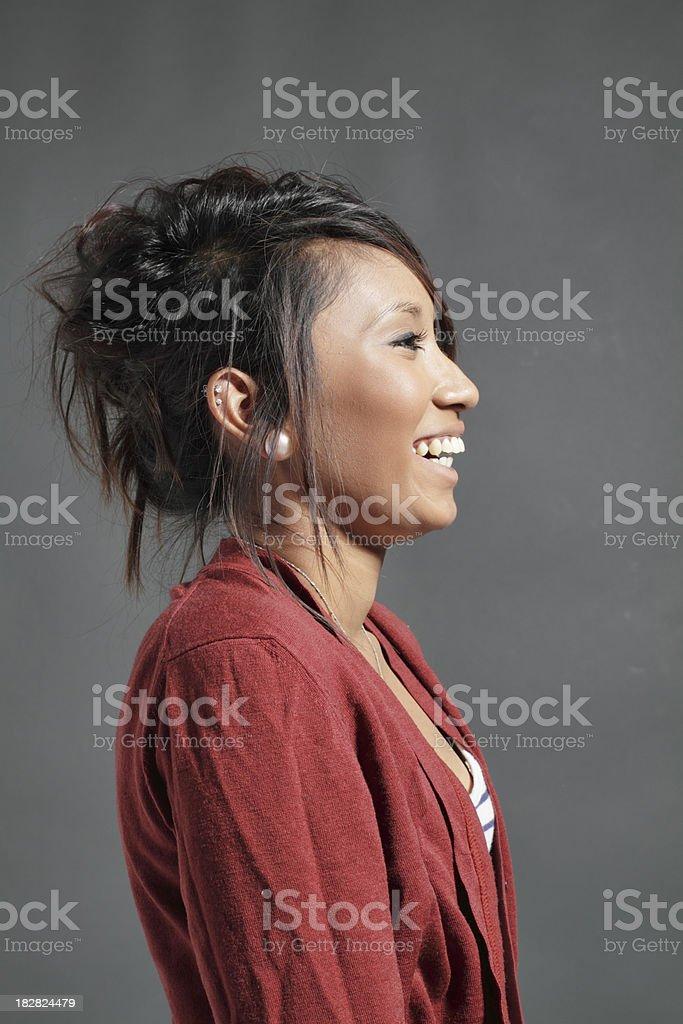Still portrait of pretty laughing teenager Guyanese girl stock photo