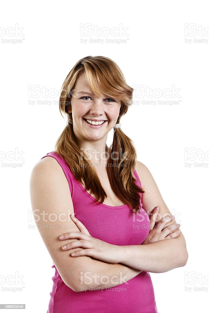 Pretty smiling teenage girl with folded arms stock photo