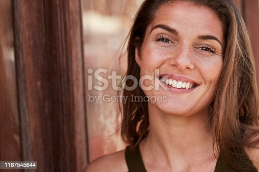 Pretty smiling brunette woman, portrait in close up