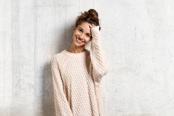 Pretty smiling young woman in cozy  sweater. stock photo