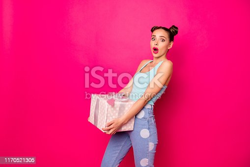 istock Pretty speechless lady holding large giftbox hands not expect such surprise wear casual outfit isolated pink background 1170521305