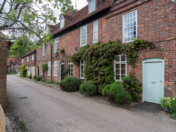 Pretty street of brick houses in village of Hambleden Street of brick homes and houses in the Chilterns village of Hambleden in Buckinghamshire buckinghamshire stock pictures, royalty-free photos & images