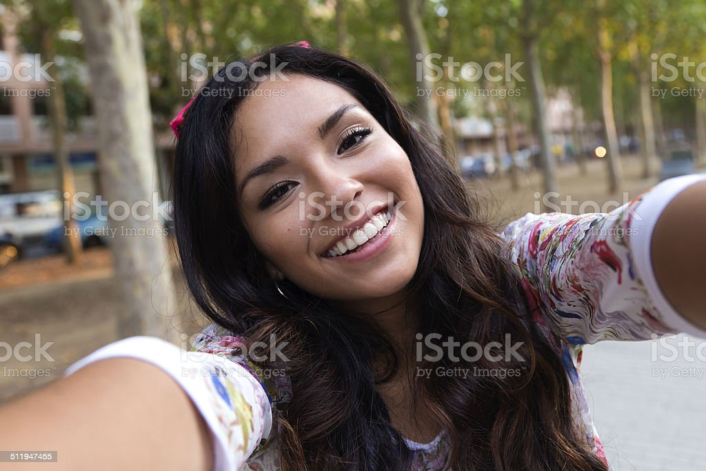 Pretty student girl taking a selfie. stock photo