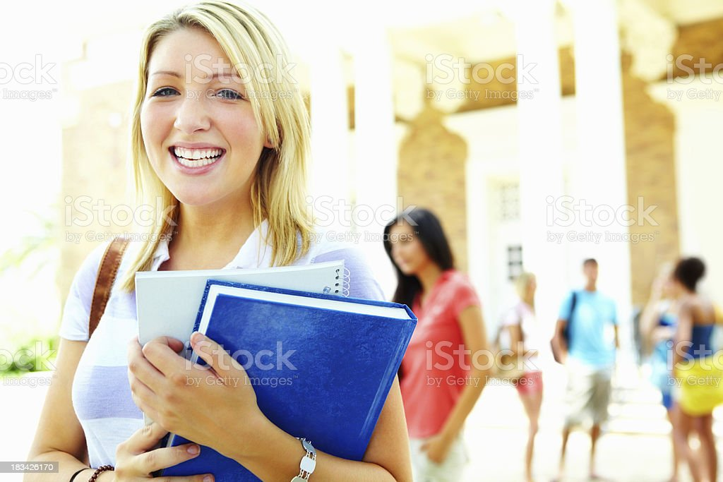 Pretty student standing at university campus royalty-free stock photo