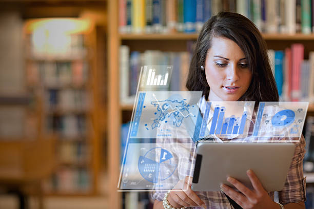hübsche student arbeiten auf ihrem futuristische tablet - schule der zukunft stock-fotos und bilder