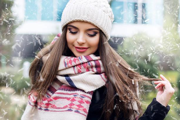 pretty teen girl is wearing warm winter clothes - wintermantel damen wolle stock-fotos und bilder