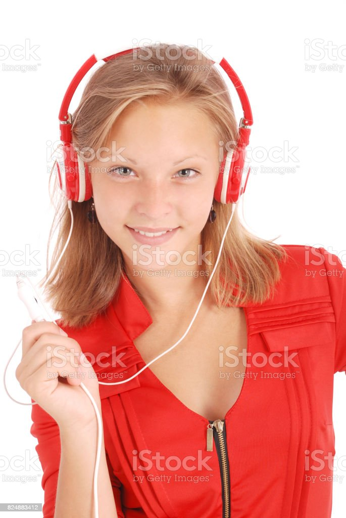 Pretty teenage girl listening music on her headphones stock photo