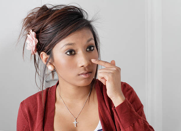 big-eyed pretty teenager guyanese girl putting on make-up - whiteway guyanese stock photos and pictures