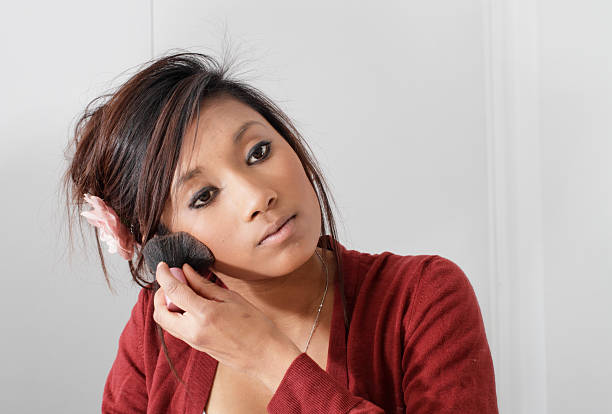 pretty teenager guyanese girl putting on blusher make-up - whiteway guyanese stock photos and pictures