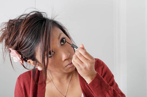pretty teenager guyanese girl putting on eye make-up - whiteway guyanese stock photos and pictures