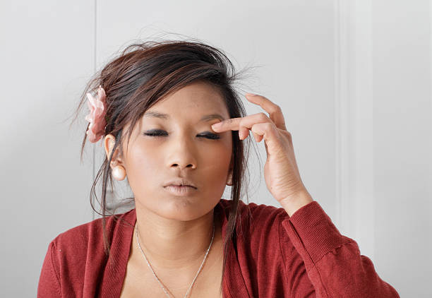 pretty teenaged guyanese girl squinitng putting on make-up - whiteway guyanese stock photos and pictures