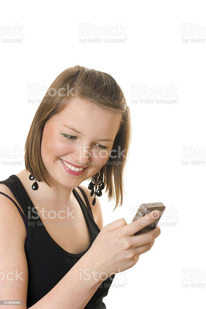 Jolie jeune fille avec téléphone portable photo libre de droits