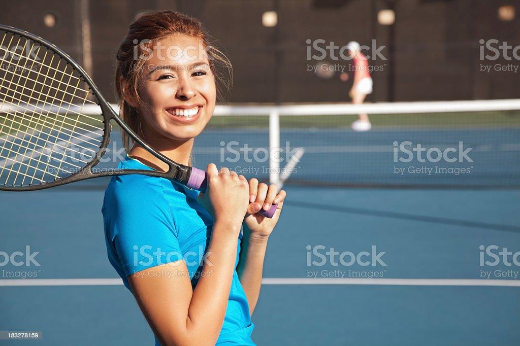 Pretty Teenage Tennis Player Playing a Match stock photo