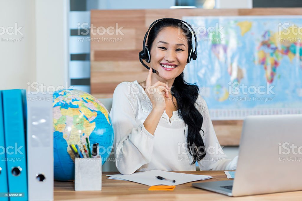 Pretty Travel Agent Smiling At Camera Stock Photo - Download Image