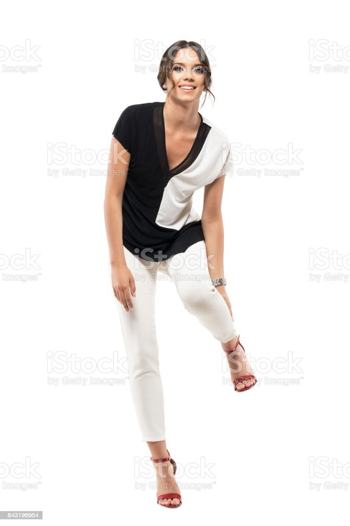 Pretty uncomfortable business woman in high heels touching ankle. stock photo