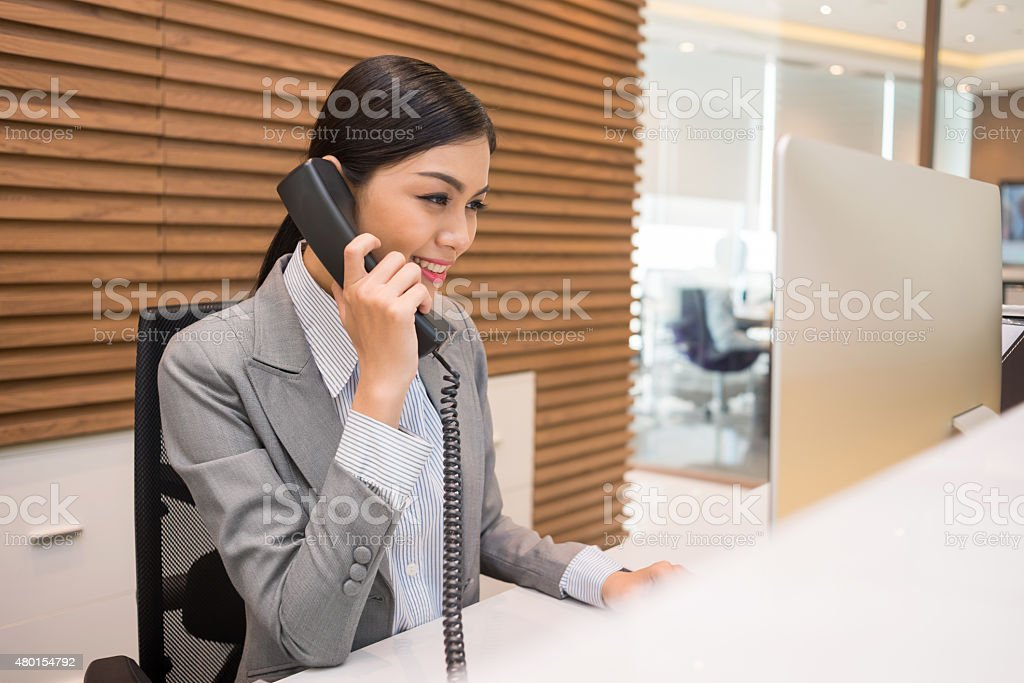 Pretty Vietnamese receptionist stock photo