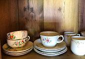 Pretty Vintage Coffee Cups on Rustic Wood Shelf