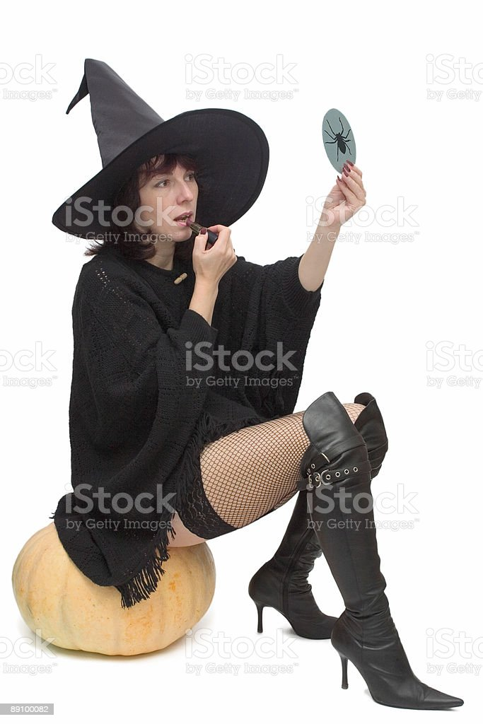 Pretty witch making up royalty-free stock photo