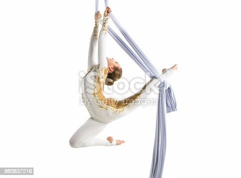 istock Pretty woman - aerialist performing aerial tricks on aerial silks. 883837216