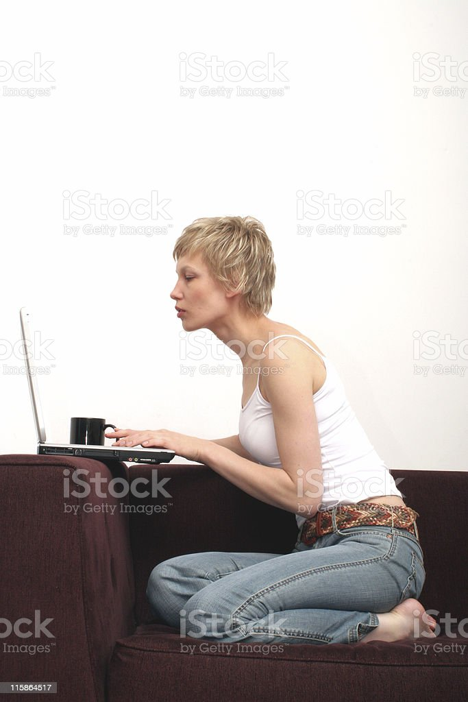Pretty woman checking message on her laptop royalty-free stock photo