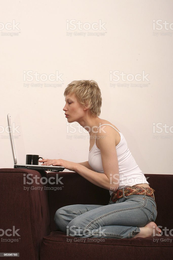 pretty woman checking message on her laptop - Royalty-free Adult Stock Photo