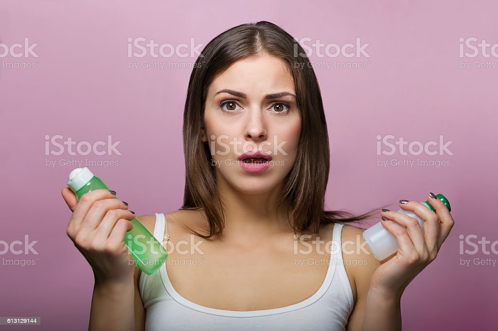 Pretty woman choosing a skin care product stock photo