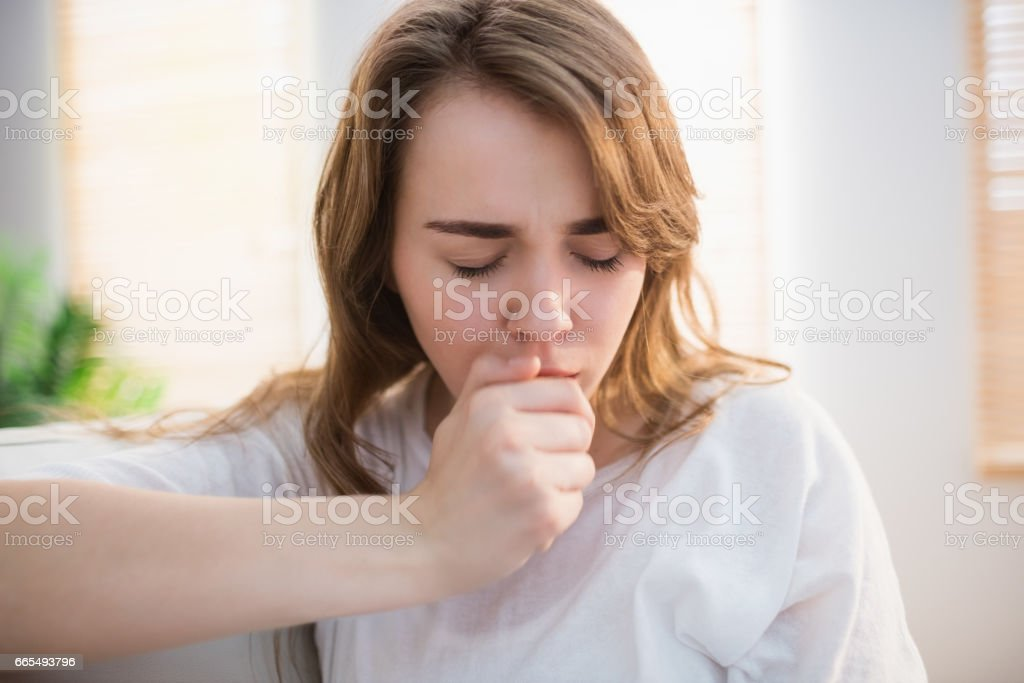 Pretty woman coughing stock photo