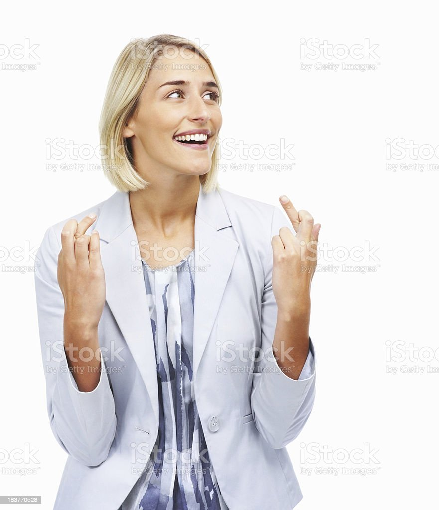 Pretty woman crossing her fingers royalty-free stock photo
