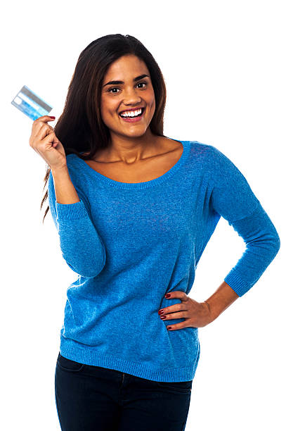 Pretty woman displaying her credit card stock photo