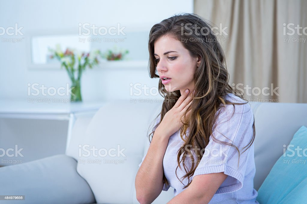 Pretty woman doing asthma crisis stock photo