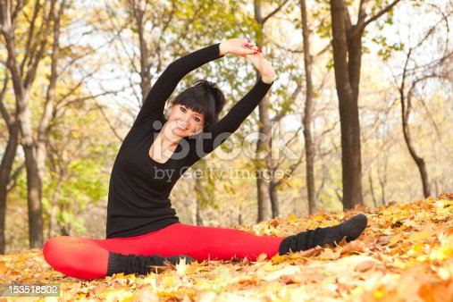 istock Pretty woman doing yoga exercises in the autumn park 153518802