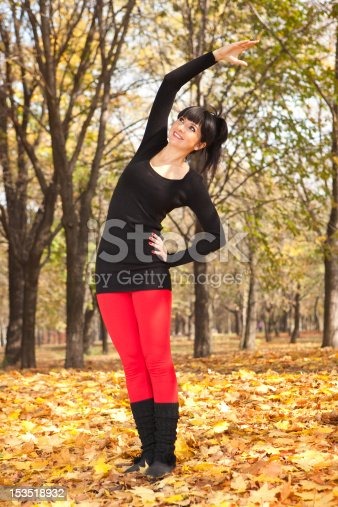 istock Pretty woman doing yoga exercises in the autumn park 153518932