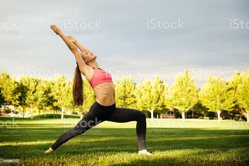 Pretty woman doing yoga exercises stock photo