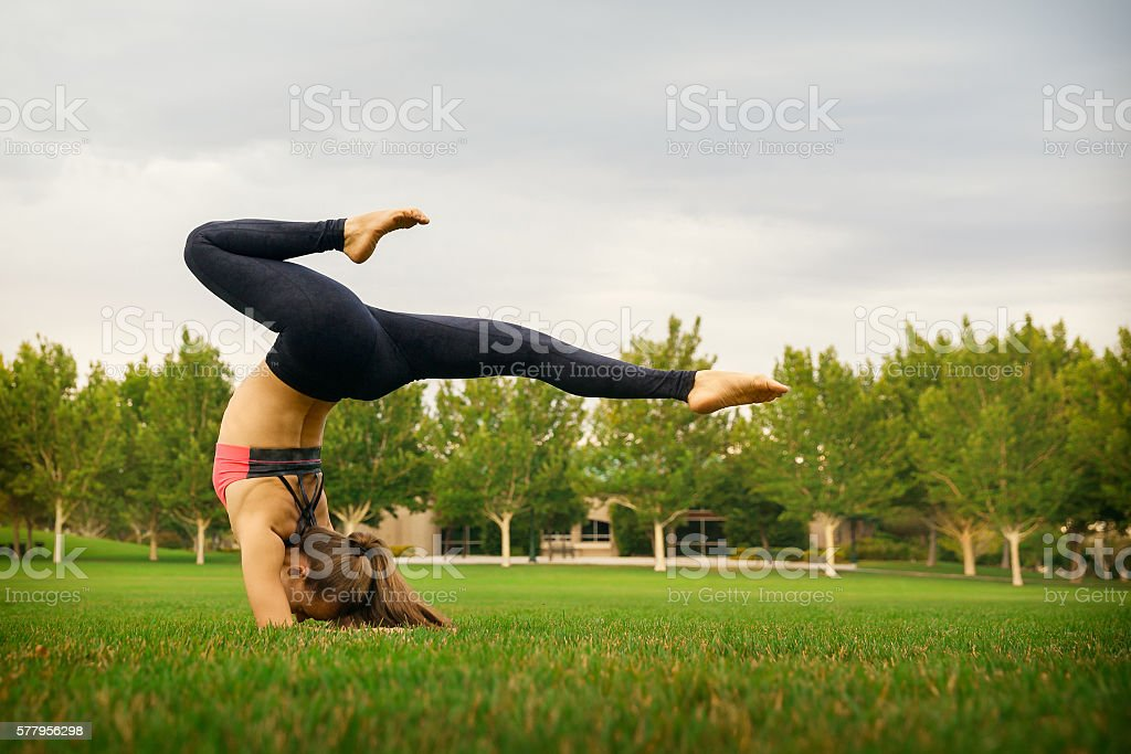 Pretty woman doing yoga exercises stock photo