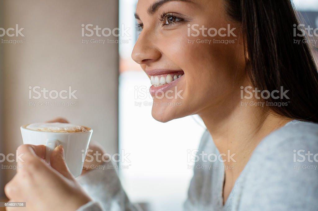 Pretty woman drinking coffee stock photo