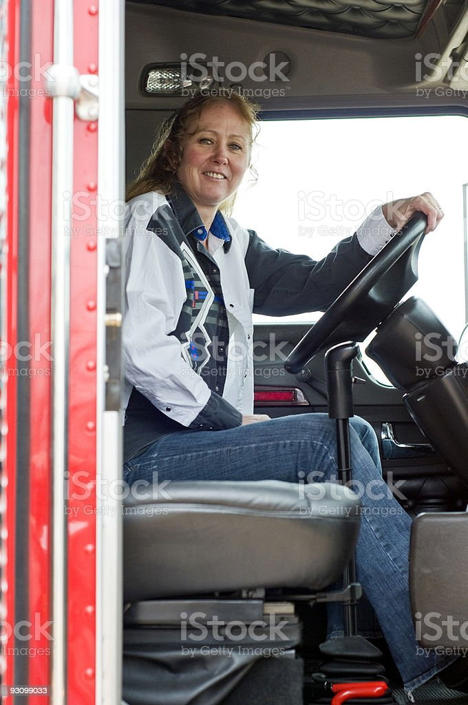 Pretty woman driving a big rig. royalty-free stock photo