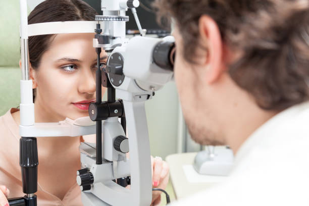 Pretty woman during an eye exam with the ophthalmologist stock photo