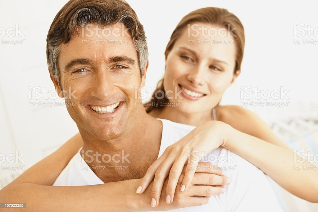 Pretty woman embracing her husband royalty-free stock photo