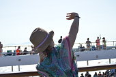 Pretty Woman Enjoying The Animations Of A Large Cruise Ship. Recreation Cruise Happiness.