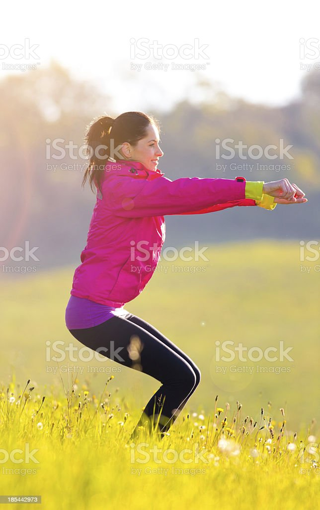Pretty woman exercising on a meadow royalty-free stock photo
