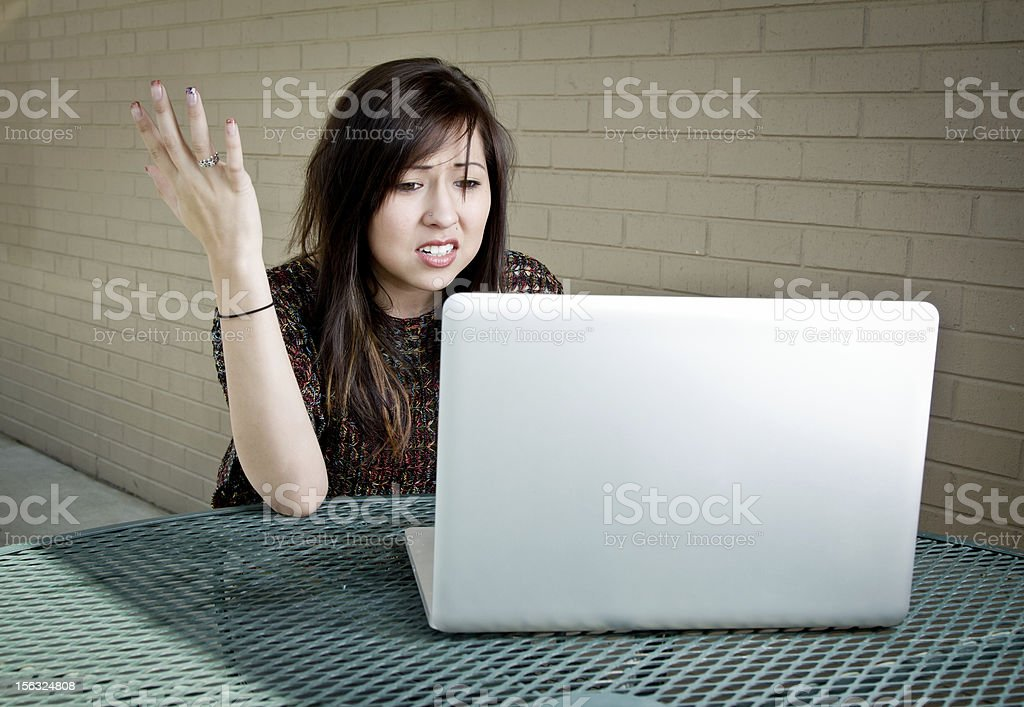Pretty Woman Frustrated with Laptop Computer stock photo