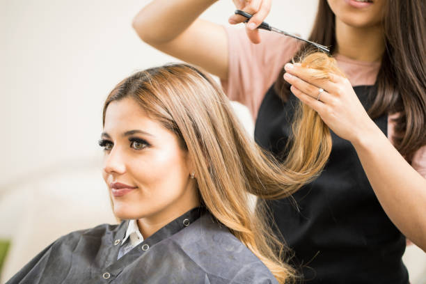 pretty woman getting a haircut - hairstyle stock photos and pictures